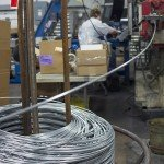 Wire for hooks being pulled from spool at Trion